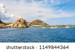 yachts at the beach on vulcano... | Shutterstock . vector #1149844364