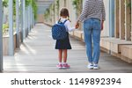 first day at school. mother... | Shutterstock . vector #1149892394