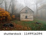 cabin in fog and autumn color... | Shutterstock . vector #1149916394