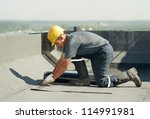 roofer preparing part of... | Shutterstock . vector #114991981