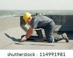 roofer preparing part of... | Shutterstock . vector #114991981