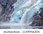 a glacier with blue ice in... | Shutterstock . vector #1149956354