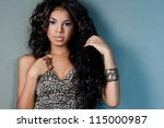 sexy mulatto girl with long hair | Shutterstock . vector #115000987