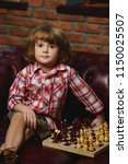 little boy playing chess at... | Shutterstock . vector #1150025507