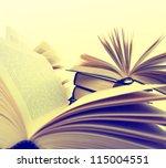 many hardcover books. toned... | Shutterstock . vector #115004551
