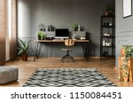 patterned carpet and pouf in... | Shutterstock . vector #1150084451