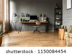 chair at wooden table with... | Shutterstock . vector #1150084454