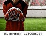 goalkeeper catches the ball   Shutterstock . vector #1150086794
