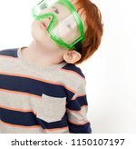 red haired boy in protective... | Shutterstock . vector #1150107197