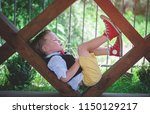 little hipster boy on nature.... | Shutterstock . vector #1150129217