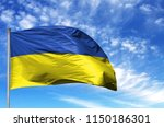 national flag of ukraine on a... | Shutterstock . vector #1150186301