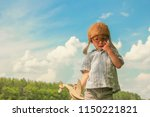 a  boy pilot with airplane | Shutterstock . vector #1150221821