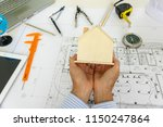 engineering woman holding ... | Shutterstock . vector #1150247864