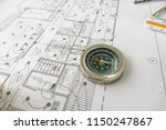 a compass places on blueprint... | Shutterstock . vector #1150247867