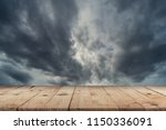 empty wooden table and dramatic ... | Shutterstock . vector #1150336091