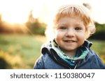 a little toddler boy standing... | Shutterstock . vector #1150380047