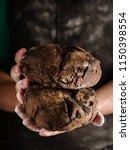 female hands hold rye bread on... | Shutterstock . vector #1150398554