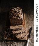 sliced homemade rye bread.... | Shutterstock . vector #1150399097