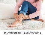 closeup woman sitting on sofa...   Shutterstock . vector #1150404041