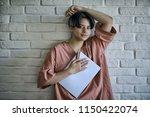 adult girl draws on paper... | Shutterstock . vector #1150422074