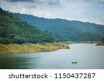 scenic mountain range next to... | Shutterstock . vector #1150437287