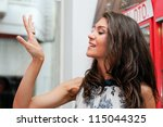 Portrait of attractive young woman trying on a ring at a jewelry - stock photo
