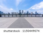 empty square with city skyline... | Shutterstock . vector #1150449074