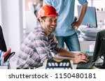 handsome cheerful engineer is... | Shutterstock . vector #1150480181