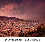 dark sunset clouds at Monte Carlo port, Monaco - stock photo
