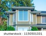 a perfect neighborhood. houses... | Shutterstock . vector #1150501331