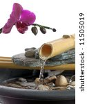 zen fountain with an orchid - stock photo