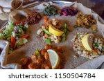 injera is a sourdough flatbread ... | Shutterstock . vector #1150504784