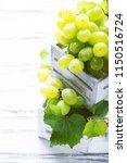 white grapes on the white...   Shutterstock . vector #1150516724