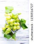 white grapes on the white...   Shutterstock . vector #1150516727