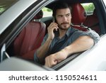 handsome man using phone while... | Shutterstock . vector #1150524611