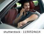 handsome man using phone while... | Shutterstock . vector #1150524614