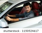 handsome man using phone while... | Shutterstock . vector #1150524617