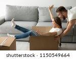happy couple play childish... | Shutterstock . vector #1150549664