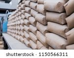 row of raw cement bag stack on... | Shutterstock . vector #1150566311