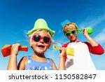 cute little boy and girl play... | Shutterstock . vector #1150582847