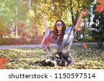 young woman throw leaves in a...   Shutterstock . vector #1150597514