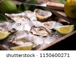 oysters on crushed ice close up  | Shutterstock . vector #1150600271