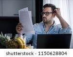 man using laptop computer ... | Shutterstock . vector #1150628804