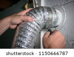 Flexible dryer vent hose, attaching/detaching from wall vent by turning screw in steel duct clamp.