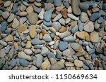 dark neutral colorful pebble... | Shutterstock . vector #1150669634