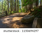 large boulders decorating the... | Shutterstock . vector #1150694297