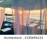 sunrise in beach sea. sun beds...   Shutterstock . vector #1150696121