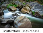 boulders and small cascades... | Shutterstock . vector #1150714511