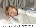 cute little blond toddler girl... | Shutterstock . vector #1150732097
