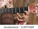 closup on guitar and hand - stock photo